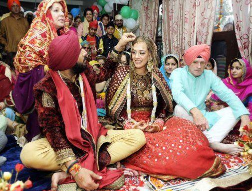 Yuvraj Singh & Hazel Keech performing wedding rituals