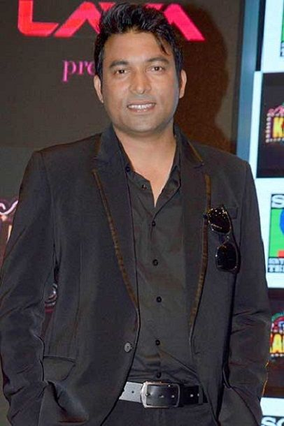 Chandra Prabhakar posing at an event