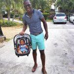 Darren Sammy with his son