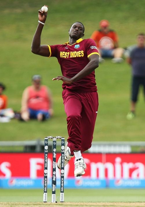 Jason Holder bowling