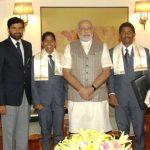 Malavath Poorna with Narendra Modi