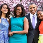 Michelle Obama with her children and husband