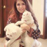 Momina with pet cats