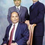 Dhirubhai Ambani (sitting) with his sons Mukesh (left) and Anil (right)
