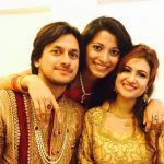 Neethusha Cherckal with her brother and sister in law