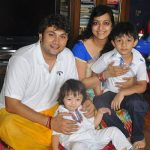Rajesh Kumar with his wife and children