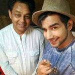 Rishi Dev with his father