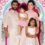 Urvashi Sharma with her husband and daughters