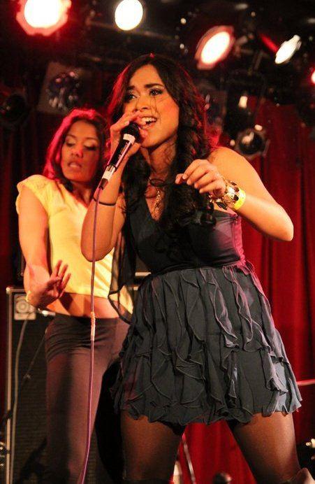 Shweta Subram singing at an event