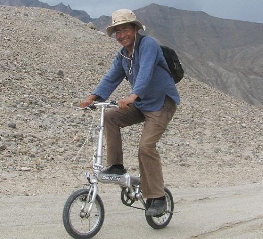 Sonam Wangchuk riding an innovative cycle