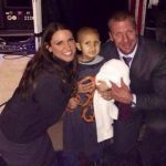 Stephanie and Triple H with Connor Michalek