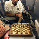 Yuzvendra Chahal and Ish Sodhi playing chess in flight