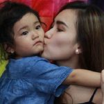 single mother Ayu Ting Ting with her daughter