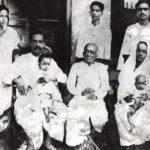 A. C. Bhaktivedanta Swami Prabhupada With His Keluarga (1924), From Left His Wife Radharani (Standing), Swami Prabhupada (Sitting with His Son Prayag Raj), His Father Gaur Mohan De (Sitting), His Nephew Tulsi (Standing, Backside of Gaur Mohan De), His Sister Rajesvari With His Daughter Sulakshman (Sitting), His Brother Krishna Charan (Standing)