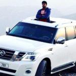 Aakash Kumar Sehdev poses with his car Nissan Pathfinder
