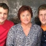Andrei Koscheev with his mother and brother