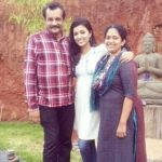Anju Kurian with her parents