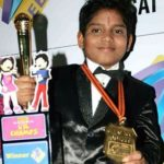 Hemant Brijwasi with his Lil Champs's Trophy