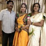 Navya Nair with her parents