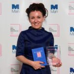 Olga Tokarczuk with Her Initernational Man Booker Prize Trophy