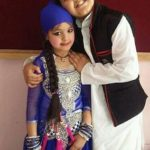 Pakhi Mendola with her brother