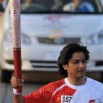 Pakistani Singer Shehzad Roy Holds the Olympic Torch as he runs around the Sports Complex Beijing 2008-