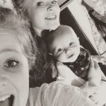 Pippa Hughes with her baby brother and elder sister
