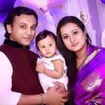 Purnima with husband and daughter