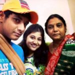 Ricky Bhui with his mother and sister