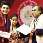 Vidit Sharma receiving merit certificate from Mukesh Ambani