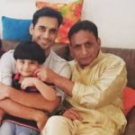 Waseem Mushtaq with his father and son